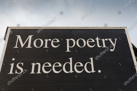 Stock Photo of The 'More Poetry Is Needed' graffiti, produced by Jeremy Deller for the Dylan Thomas Centenary
