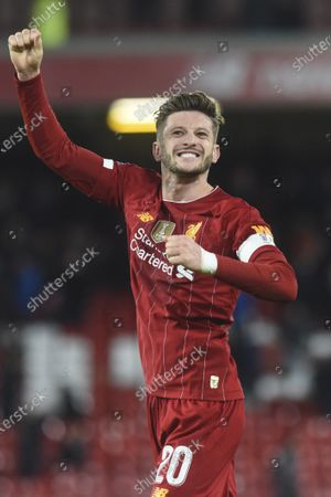 Liverpool player Adam Lallana celebrates to fans in the Kop after the final whistle.