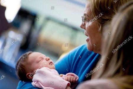 Elizabeth Warren, Matilda Layton. Democratic presidential candidate Sen. Elizabeth Warren, D-Mass., holds Hannah Simpson's newborn, Matilda Layton, of Bellevue, Iowa, during at a campaign stop at Moore Family Farms, in Maquoketa, Iowa