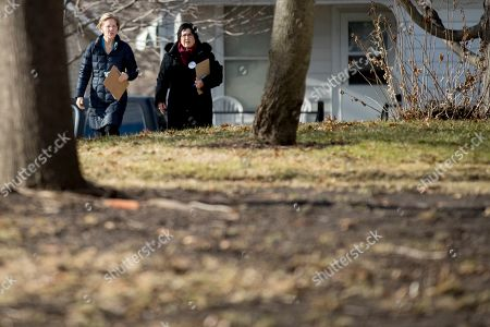Elizabeth Warren, Donna Duvall. Democratic presidential candidate Sen. Elizabeth Warren, D-Mass., left, accompanied by Jackson County Democratic Party chair Donna Duvall, right, knocks on doors to speak to undecided caucusgoers, in Maquoketa, Iowa
