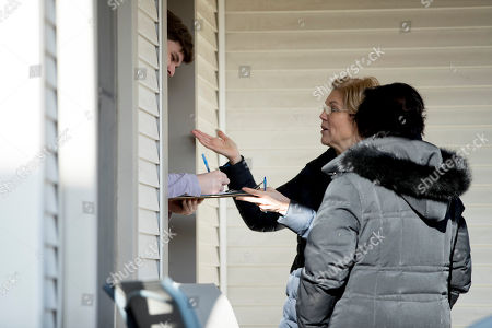 Elizabeth Warren, Donna Duvall. Democratic presidential candidate Sen. Elizabeth Warren, D-Mass., second from right, accompanied by Jackson County Democratic Party chair Donna Duvall, right, gets a resident to sign up with her as she knocks on doors to speak to undecided caucus goers, in Maquoketa, Iowa