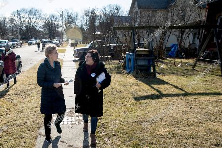 Elizabeth Warren, Donna Duvall. Democratic presidential candidate Sen. Elizabeth Warren, D-Mass., left, accompanied by Jackson County Democratic Party chair Donna Duvall, right, knocks on doors to speak to undecided caucus goers, in Maquoketa, Iowa