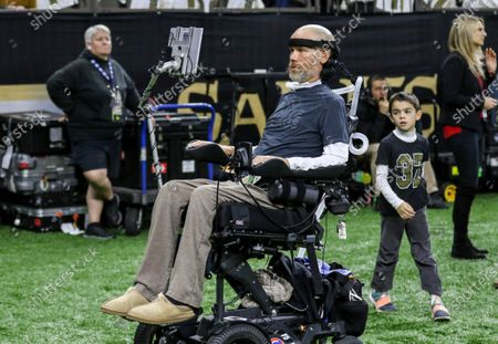 Former New Orleans Saints player Steve Gleason is on the sideline before NFL Wild Card Playoff action between the New Orleans Saints and the Minnesota Vikings at the Mercedes Benz Superdome in New Orleans, LA