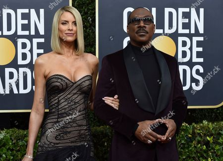 Paige Butcher, Eddie Murphy. Paige Butcher, left, and Eddie Murphy arrive at the 77th annual Golden Globe Awards at the Beverly Hilton Hotel, in Beverly Hills, Calif