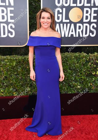 Kit Hoover arrives at the 77th annual Golden Globe Awards at the Beverly Hilton Hotel, in Beverly Hills, Calif