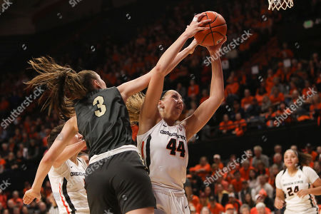 Colorado's Emma Clarke (3) and Oregon State's Taylor Jones (44) fight for possession of a rebound during the first half of an NCAA college basketball game in Corvallis, Ore