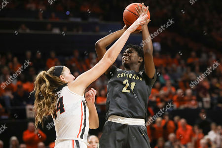 Colorado's Mya Hollingshed (21) tries to shoot over Oregon State's Taylor Jones (44) during the second half of an NCAA college basketball game in Corvallis, Ore