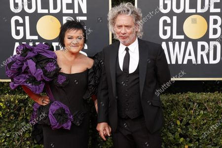 Dexter Fletcher (R) and wife Dalia Ibelhauptaite arrive for the 77th annual Golden Globe Awards ceremony at the Beverly Hilton Hotel, in Beverly Hills, California, USA, 05 January 2020.