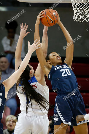 Connecticut forward Olivia Nelson-Ododa (20) grabs a rebound in front of SMU center Paige Bayliss (14) during the first half of an NCAA college basketball game in University Park,Texas