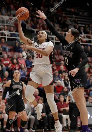 Haley Jones, Haley Van Dyke. Stanford's Haley Jones, front left, shoots against Washington's Haley Van Dyke (11) in the second half of an NCAA college basketball game, in Stanford, Calif