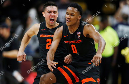 R m. Oregon State guard Jarod Lucas, left, jumps onto guard Gianni Hunt as they celebrate as time runs out in the second half of an NCAA college basketball game against Colorado, in Boulder, Colo