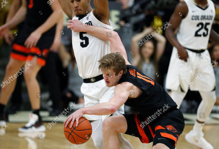 R m. Oregon State guard Zach Reichle, front, pulls in a loose ball as Colorado guard D'Shawn Schwartz defends in the second half of an NCAA college basketball game, in Boulder, Colo. Oregon State came from behind to win 76-68