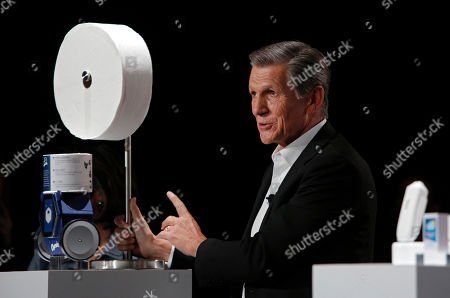 Procter & Gamble Chief Brand Officer Marc Pritchard shows off the Charmin Forever Roll and the Charmin RollBot during a Procter & Gamble news conference before CES International, in Las Vegas