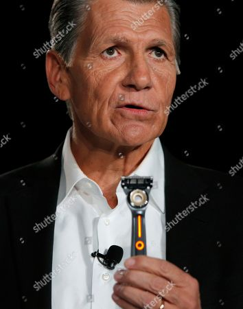 Procter & Gamble Chief Brand Officer Marc Pritchard shows holds up the Gillette Heated Razor during a Procter & Gamble news conference before CES International, in Las Vegas