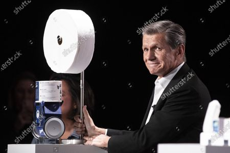 P&G (Procter & Gamble) chief brand officer Marc Pritchard presents a large roll of toilet paper as a joke next to the Charmin toilet paper robot on display during the P&G (Procter & Gamble) press conference at the 2020 International Consumer Electronics Show in Las Vegas, Nevada, USA, 05 January 2020. The annual CES which takes place from 7-10 January is a place where industry manufacturers, advertisers and tech-minded consumers converge to get a taste of new innovations coming to the market each year.