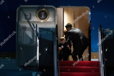 A Secret Service agent stops Theodore James Kushner, a son of Ivanka Trump, from exiting Air Force One, at Andrews Air Force Base, Md., following a trip from Trump's Mar-a-Lago estate