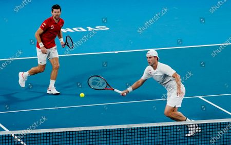 Oliver Marach and Juergen Melzer of Austria in action during their doubles match against Maximo Gonzalez and Andres Molteni of Argentina during day 4 of the ATP Cup tennis tournament at Ken Rosewall Arena in Sydney, New South Wales, Australia, 06 January 2020.