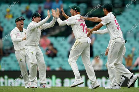 Stock Picture of James Pattinson of Australia (2-R) celebrates with teammates after taking a diving catch to dismiss Todd Astle of New Zealand on day 4 of the third Test Match between Australia and New Zealand at the Sydney Cricket Ground (SCG) in Sydney, New South Wales, Australia, 06 January 2020.