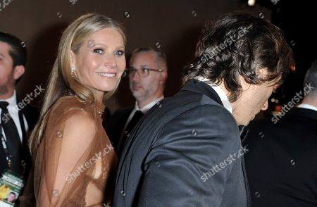 Stock Image of Gwyneth Paltrow, Brad Falchuk. Gwyneth Paltrow, left, and Brad Falchuk attend the 77th annual Golden Globe Awards at the Beverly Hilton Hotel, in Beverly Hills, Calif