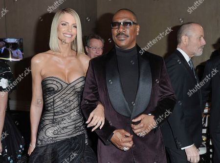 Paige Butcher, Eddie Murphy. Paige Butcher, left, and Eddie Murphy attend the 77th annual Golden Globe Awards at the Beverly Hilton Hotel, in Beverly Hills, Calif
