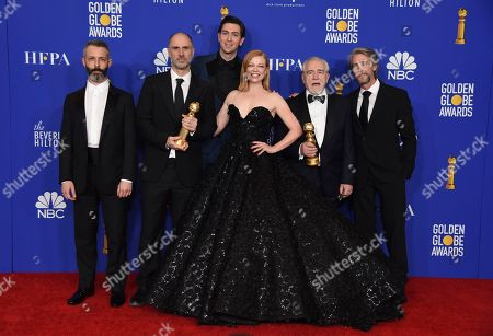 """Jeremy Strong, Jesse Armstrong, Nicholas Braun, Sarah Snook, Brian Cox, Alan Ruck. Jeremy Strong, from left, Jesse Armstrong, Nicholas Braun, Sarah Snook, Brian Cox, and Alan Ruck, from the cast and crew of """"Succession,"""" pose in the press room with the award for best television series, drama, at the 77th annual Golden Globe Awards at the Beverly Hilton Hotel, in Beverly Hills, Calif"""