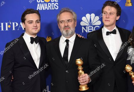 Dean-Charles Chapman, Sam Mendes, George MacKay. Dean-Charles Chapman, from left, Sam Mendes and George MacKay pose in the press room with the award for best motion picture drama at the 77th annual Golden Globe Awards at the Beverly Hilton Hotel, in Beverly Hills, Calif
