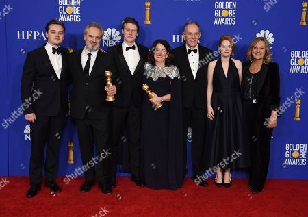 """Dean-Charles Chapman, Sam Mendes, George MacKay, Pippa Harris, Krysty Wilson-Cairns. Cast and crew of """"1917,"""" pose in the press room with the award for best motion picture drama at the 77th annual Golden Globe Awards at the Beverly Hilton Hotel, in Beverly Hills, Calif"""