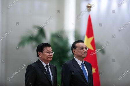 Chinese Premier Li Keqiang (R) and Prime Minister of Laos Thongloun Sisoulith (L) attend a welcome ceremony at the Great Hall of the People in Beijing, China, 06 January 2020.