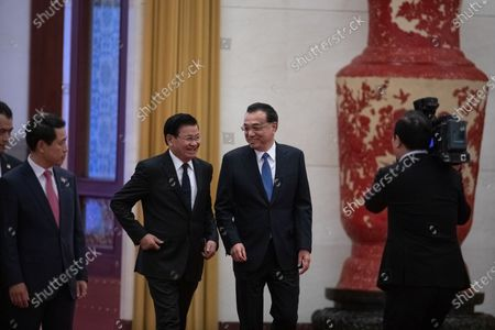 Chinese Premier Li Keqiang (R) and Prime Minister of Laos Thongloun Sisoulith (L) arrive for a welcome ceremony at the Great Hall of the People in Beijing, China, 06 January 2020.