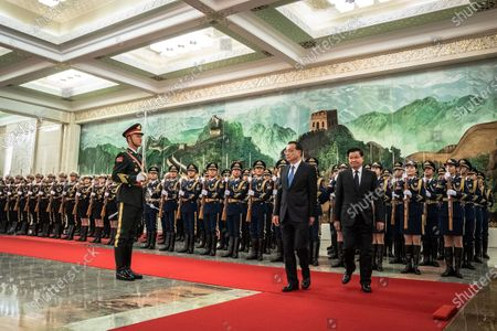 Chinese Premier Li Keqiang (C) and Prime Minister of Laos Thongloun Sisoulith (R) inspect an honor guard during a welcome ceremony at the Great Hall of the People in Beijing, China, 06 January 2020.