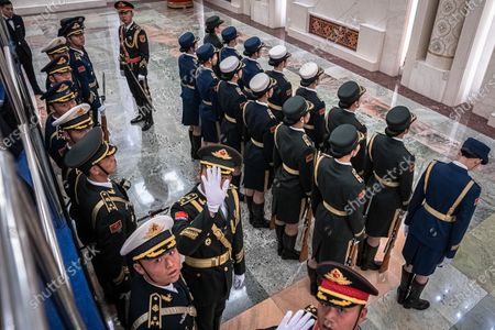 Members of an honor guard gesture to the photographer to stop taking photos prior to a welcome ceremony for Prime Minister of Laos Thongloun Sisoulith at the Great Hall of the People in Beijing, China, 06 January 2020.