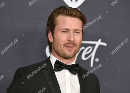 Glen Powell arrives at the InStyle and Warner Bros. Golden Globes afterparty at the Beverly Hilton Hotel, in Beverly Hills, Calif