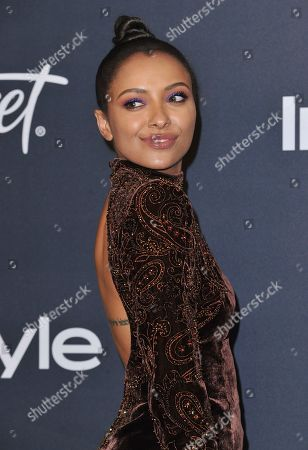 Kat Graham arrives at the InStyle and Warner Bros. Golden Globes afterparty at the Beverly Hilton Hotel, in Beverly Hills, Calif