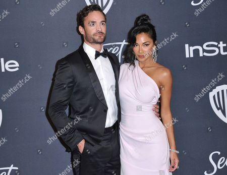 Thom Evans, Nicole Scherzinger. Thom Evans, left, and Nicole Scherzinger arrive at the InStyle and Warner Bros. Golden Globes afterparty at the Beverly Hilton Hotel, in Beverly Hills, Calif