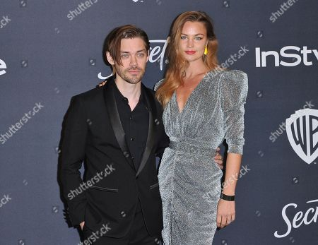 Tom Payne, Jennifer Akerman. Tom Payne, left, and Jennifer Akerman arrive at the InStyle and Warner Bros. Golden Globes afterparty at the Beverly Hilton Hotel, in Beverly Hills, Calif