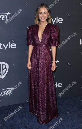 Jamie Chung arrives at the InStyle and Warner Bros. Golden Globes afterparty at the Beverly Hilton Hotel, in Beverly Hills, Calif