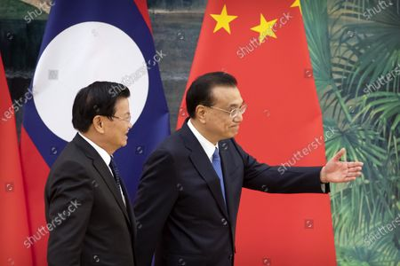 Chinese Premier Li Keqiang (R) gestures to Prime Minister of Laos Thongloun Sisoulith after a signing ceremony at the Great Hall of the People in Bejiing, China, 06 January 2020.