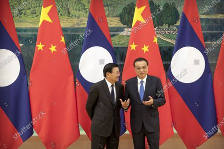 Laos' Prime Minister Thongloun Sisoulith (L) and Chinese Premier Li Keqiang (R) talk before a signing ceremony at the Great Hall of the People in Bejiing, China, 06 January 2020.