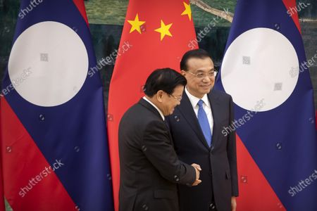 Chinese Premier Li Keqiang (R) shakes hands with Prime Minister of Laos Thongloun Sisoulith (L) after a signing ceremony at the Great Hall of the People in Bejiing, China, 06 January 2020.