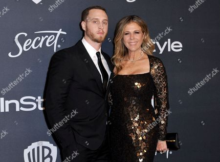 Stock Picture of Chet Hanks, Rita Wilson. Chet Hanks, left, and Rita Wilson arrive at the InStyle and Warner Bros. Golden Globes afterparty at the Beverly Hilton Hotel, in Beverly Hills, Calif