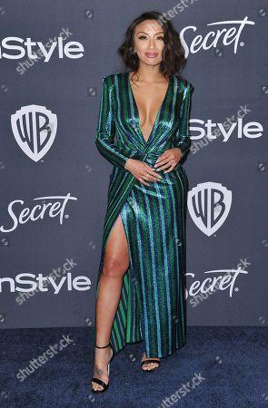 Jeannie Mai arrives at the InStyle and Warner Bros. Golden Globes afterparty at the Beverly Hilton Hotel, in Beverly Hills, Calif