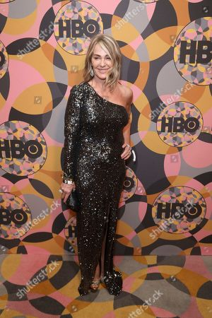 Nadia Comaneci arrives at the HBO Golden Globes afterparty at the Beverly Hilton Hotel, in Beverly Hills, Calif