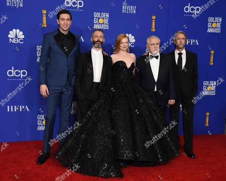 """Nicholas Braun, Jeremy Strong,Sarah Snook, Brian Cox, Alan Ruck. Nicholas Braun, from left, Jeremy Strong, Sarah Snook, Brian Cox and Alan Ruck, from the cast and crew of """"Succession,"""" pose in the press room with the award for best television series, drama, at the 77th annual Golden Globe Awards at the Beverly Hilton Hotel, in Beverly Hills, Calif"""