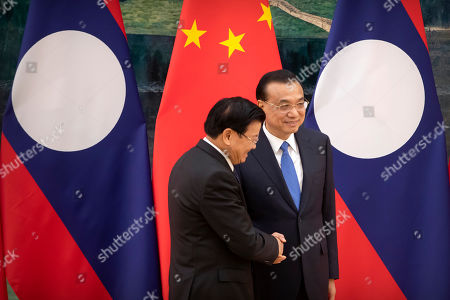 Thongloun Sisoulith, Li Keqiang. Laos' Prime Minister Thongloun Sisoulith, left, and Chinese Premier Li Keqiang shake hands after a signing ceremony at the Great Hall of the People in Beijing