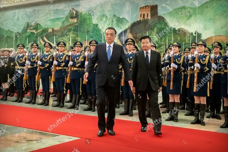 Thongloun Sisoulith, Li Keqiang. Chinese Premier Li Keqiang, left, and Laos' Prime Minister Thongloun Sisoulith review an honor guard during a welcome ceremony at the Great Hall of the People in Beijing