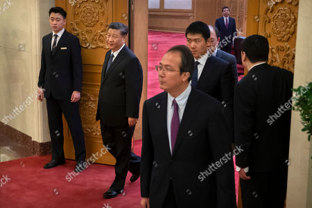 Chinese President Xi Jinping, second from left, arrives for a meeting with Laos' Prime Minister Thongloun Sisoulith at the Great Hall of the People in Beijing