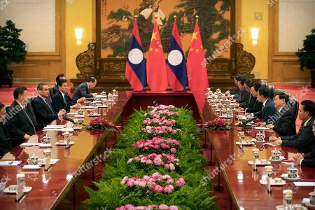 Thongloun Sisoulith, Xi Jinping. Chinese President Xi Jinping, left, speaks as Laos' Prime Minister Thongloun Sisoulith, second from right, listens during a meeting at the Great Hall of the People in Beijing