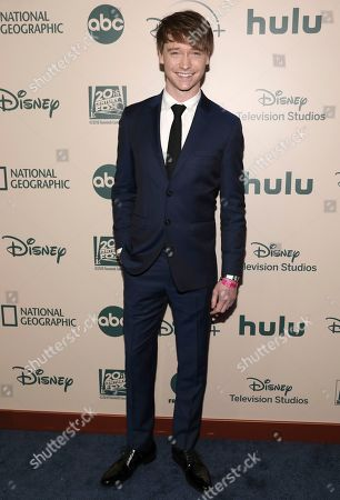 Calum Worthy arrives at the FX and Disney Golden Globes afterparty at the Beverly Hilton Hotel, in Beverly Hills, Calif