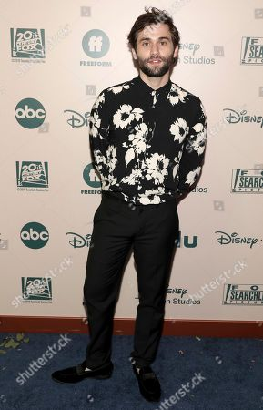 Jake Borelli arrives at the FX and Disney Golden Globes afterparty at the Beverly Hilton Hotel, in Beverly Hills, Calif
