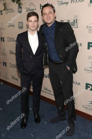 Stock Picture of Graham Patrick Martin, Lewis Pullman. Graham Patrick Martin, left, and Lewis Pullman arrive at the FX and Disney Golden Globes afterparty at the Beverly Hilton Hotel, in Beverly Hills, Calif